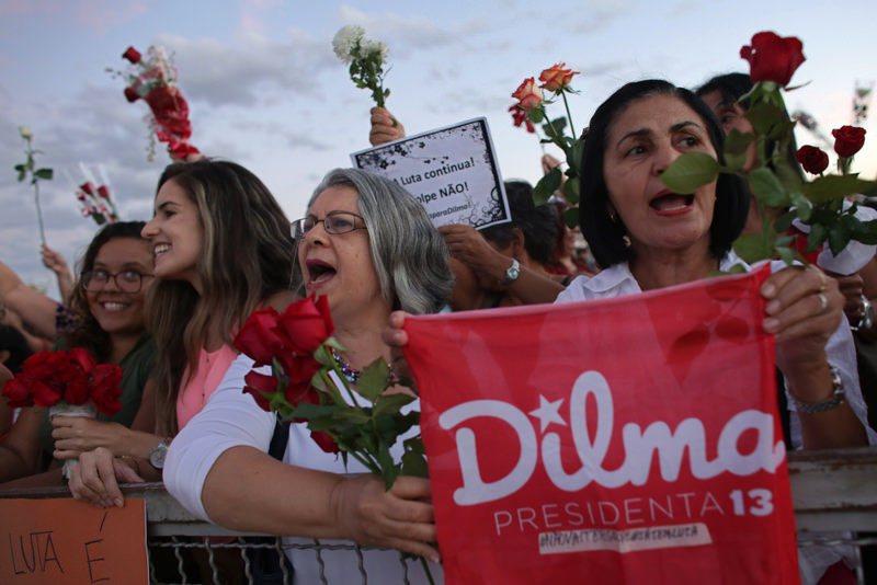 Women carrying flowers take part in ,Flowers for democracy, demonstration against the impeachment process of Brazilian President Dilma Rousseff, in Brasilia.