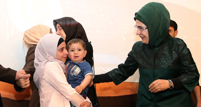 Emine Erdoğan (R) with Rua (C) who embraces her sister's son during the tearful reunion. (Photo courtesy of Turkish Presidency)