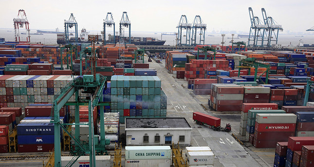 In this March 3, 2009 photo, a load of containers await export at Yangshan deep-water port in Shanghai, China. (AP Photo)