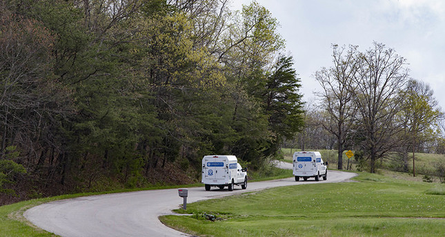 Crime scene investigation vehicles drive up Union Hill Road as they approach the location of a reported multiple shooting, Friday, April 22, 2016, in Pike County, Ohio. (AP Photo)