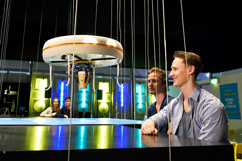 A drone brings drinks to customers in the world's first drone cafe in Eindhoven. (AFP Photo)