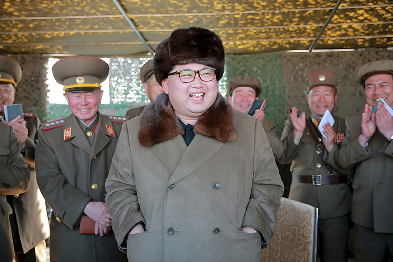 North Korean leader Kim Jong Un attends a demonstration of a new large-caliber multiple rocket launching system (Reuters Photo)