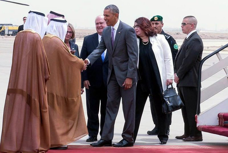 US President Barack Obama (C) being received by Prince Faisal bin Bandar bin Abdelaziz al-Saud, governor of Riyadh, upon arrival at King Khalid International Airport, Riyadh.