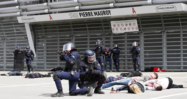 Police officers in an exercise simulating a chemical attack in view of the Euro 2016 championship at the Pierre Mauroy Stadium in Lille in northern France.