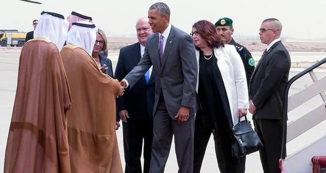 US President Barack Obama (C) being received by Prince Faisal bin Bandar bin Abdelaziz al-Saud, governor of Riyadh, upon arrival at King Khalid International Airport, Riyadh.