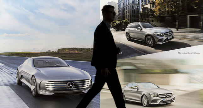 A man walks past an advertising board for Mercedes-Benz cars prior to the annual press conference of German auto giant Daimler AG in Stuttgart.