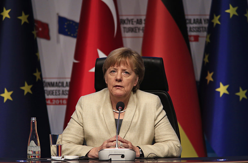 German Chancellor Angela Merkel listens during a joint news conference in Gaziantep, southeastern Turkey. (AP Photo)