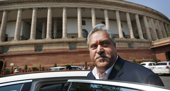 India has revoked the passport of the flamboyant Indian businessman Mallya accused of fleeing to London in March while owing more than a billion dollars to Indian banks. (AP File Photo)