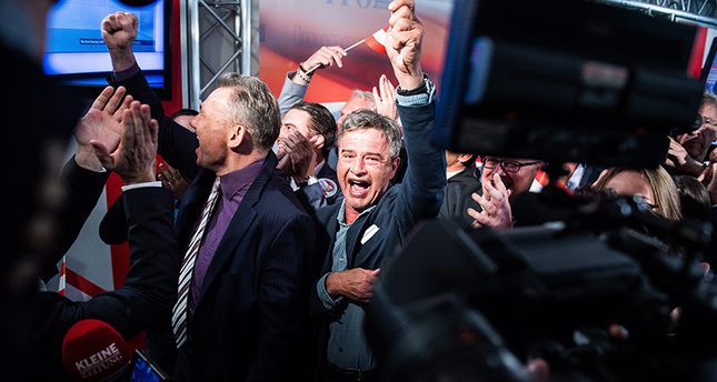 Members of the right-wing Austrian Freedom Party (FPOe) celebrate at the his party headquarters during Austrian presidential elections in Vienna, Austria, 24 April 2016. (EPA Photo)