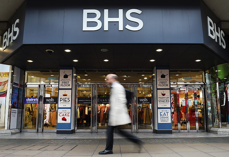 A pedestrian passes a BHS store in Oxford Street in London, Britain, 25 April 2016. (EPA Photo)