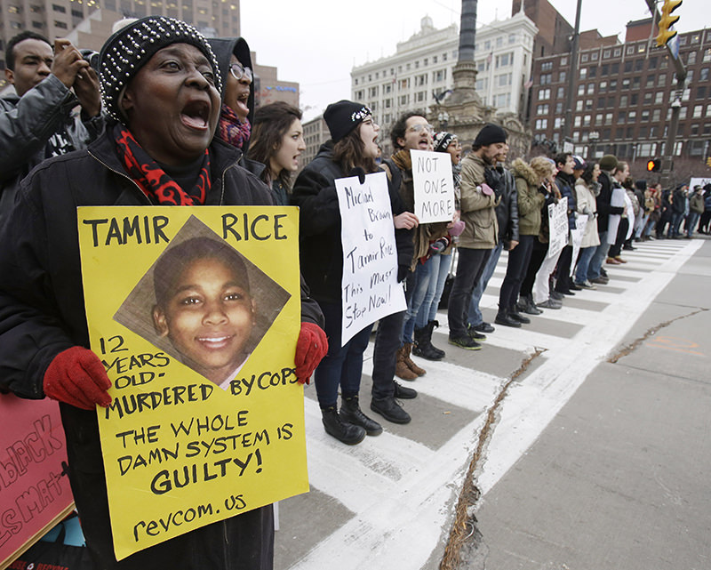 In this Nov. 25, 2014, file photo, demonstrators block Public Square in Cleveland, during a protest over the police shooting of Tamir Rice. (AP Photo)