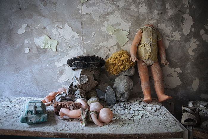 Toys and a gas mask are seen in a former kindergarten in the deserted city of Pripyat, near the Chernobyl nuclear power plant, Ukraine, 22 April 2016 (EPA Photo)