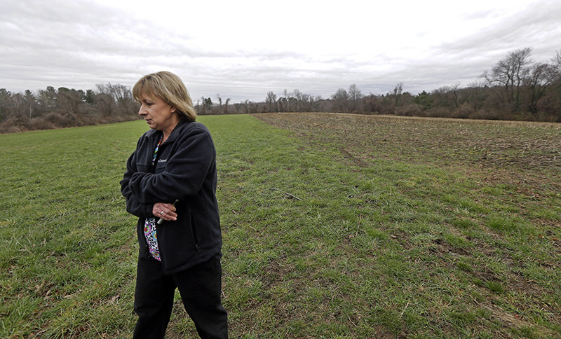 In this April 12, 2016 photo, Desiree Moninski, walks on land located across from her house in Dudley, Mass., which is the site of a proposed Muslim cemetery (AP Photo)