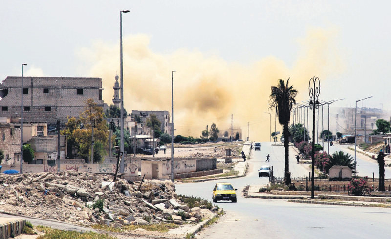 Smoke rising on a main road in the Salaheddin neighborhood of Syria's northern city of Aleppo following a reported airstrike.