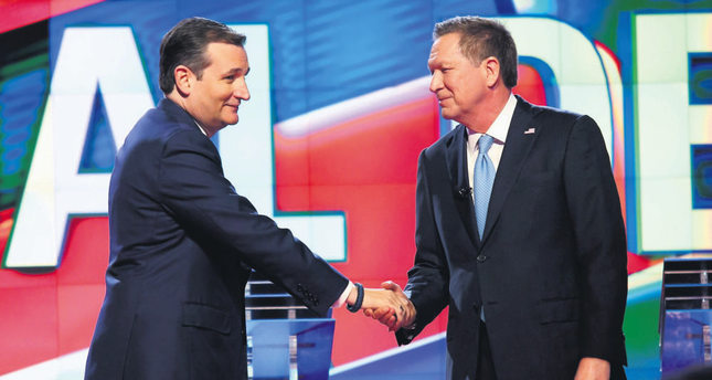 US Republican presidential candidates Ted Cruz (L) and John Kasich (R) shake hands during the Republican National Committee Presidential Primary Debate at the University of Miami's Bank United Center, in Miami, Florida, USA on March 10.