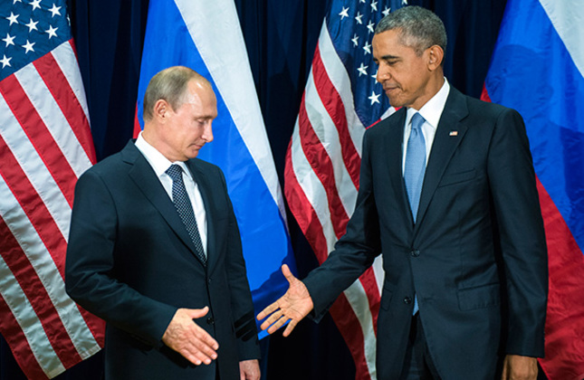 Russian President Putin (L) and U.S. President Obama (R) pose for the media before a bilateral meeting at United Nations Headquarters on Sept. 28, 2015.