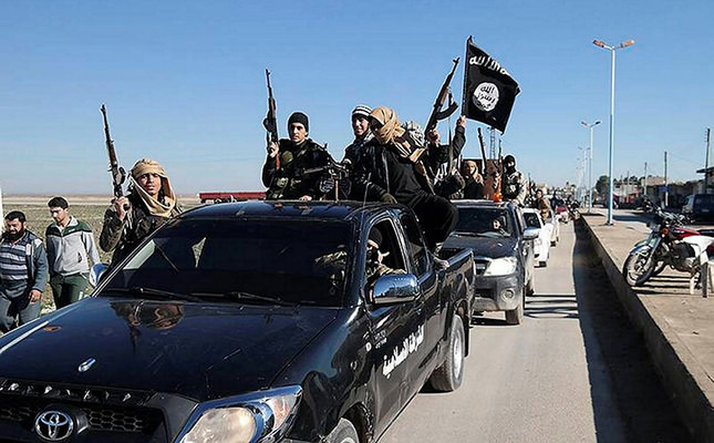 In this this file photo released on May 4, 2015, on a militant website, Daesh militants pass by a convoy in Tel Abyad, northeast Syria. (AP Photo)