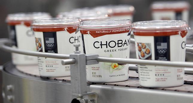 In this Jan. 21, 2014, file photo, yogurt containers run along a conveyor at the Chobani plant near Twin Falls, Idaho. (AP Photo)