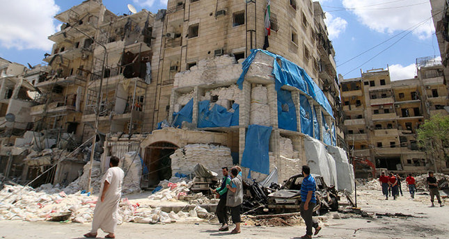 People inspect the damage at al-Quds hospital after it was hit by airstrikes, in a rebel-held area of Syria's Aleppo, April 28, 2016. REUTERS