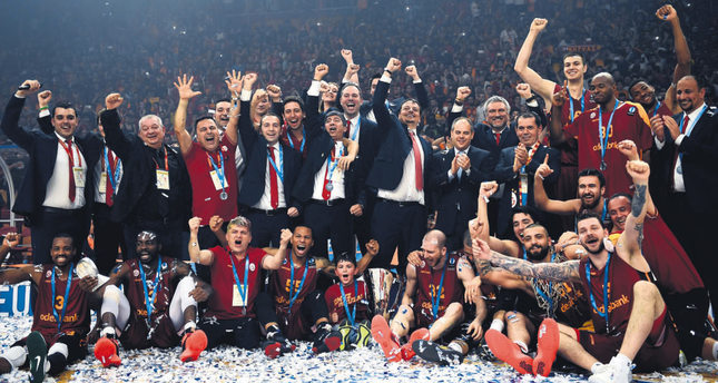 Galatasaray's team celebrates with the Eurocup trophy after the EuroCup Basketball final match Galatasaray vs Strasbourg at Abdi İpekçi arena in Istanbul.