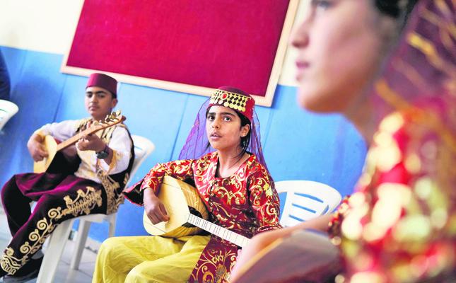 Syrian refugees attend a music class at Harran refugee camp in Şanlıurfa province.