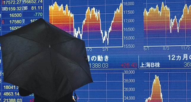 Japan slips back to deflation as markets react BoJ decision