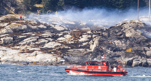 A search and rescue vessel patrols off the island of Turoey, near Bergen, Norway, as emergency workers attend the scene of a helicopter crash believed to have 13 people aboard, Friday April 29, 2016 (AP Photo)