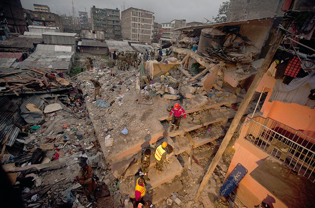 A six-story residential building in a low income area of the Kenyan capital collapsed Friday under heavy rain and flooding. (AP Photo)
