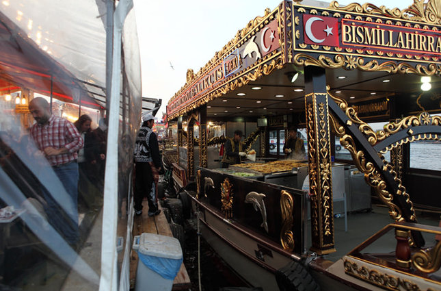 A traditional fishing boat serving fish sandwiches in Eminönü. (iStock Photo)