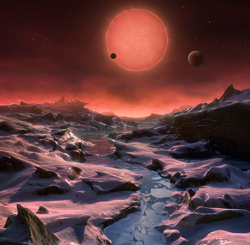 The artist's impression provided by European Southern Observatory on May 2, 2016 shows an imagined view from the surface one of the three planets. (AP Photo)