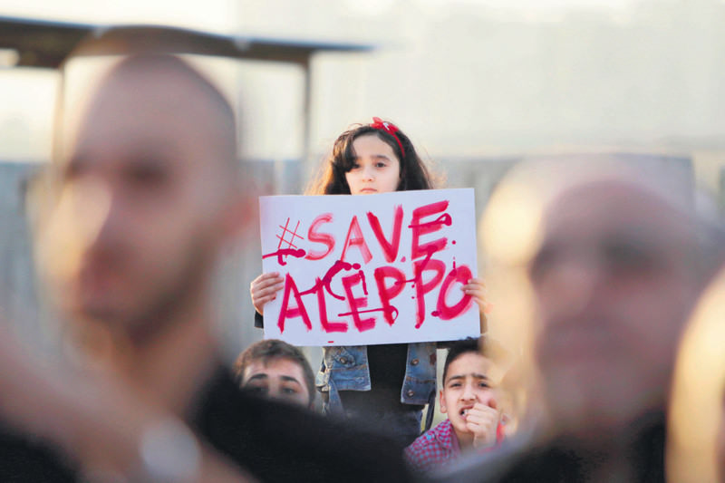 A Syrian girl holding a placard during a rally in solidarity with Aleppo, in the Lebanese northern port city of Tripoli.