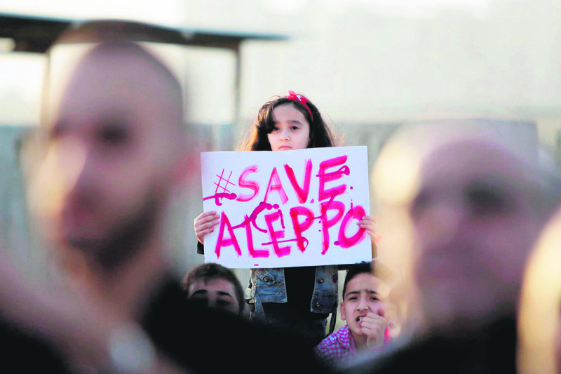 A Syrian girl holds a placard during a rally in solidarity with Aleppo in Tripoli, Lebanon.