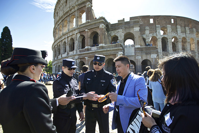 Chinese policemen are in Italy to start patrols with Italian officers in Rome and Milan in a two-week experiment. (AP Photo)