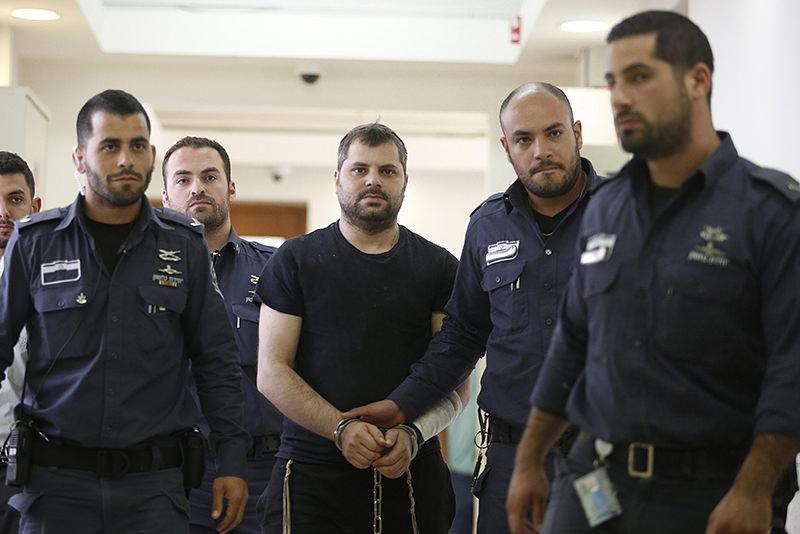 Yosef Haim Ben-David (C) is escorted to the Israeli District Court in Jerusalem, Israel, 03 May 2016. (EPA Photo)