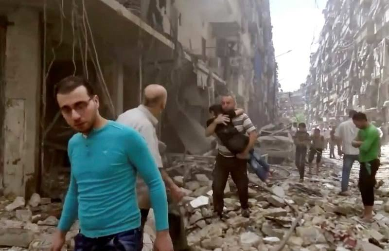 A father hugs his daughter after an air-strike hit the opposition-held part of Aleppo.