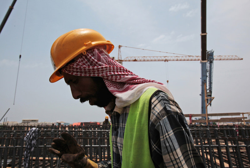 A man works on the construction of Kingdom Tower, a planned 252-story building, which would be the world's tallest skyscraper when complete, in Jiddah.