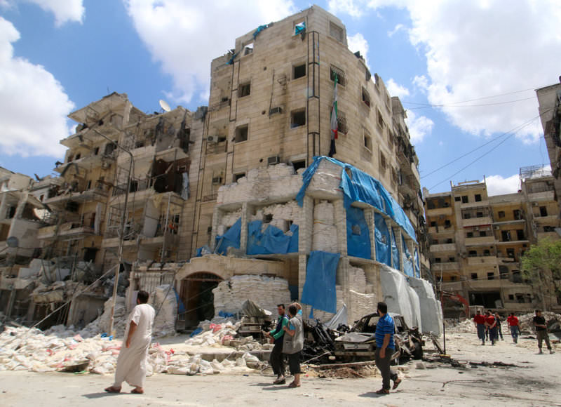 People inspecting the damage at the al-Quds hospital after it was hit by airstrikes, in a moderate-held area of Syria's Aleppo
