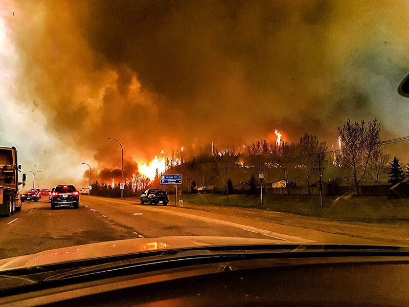 A picture provided by Twitter user @jeromegarot on 05 May 2016 shows a wildfire raging through the town of Fort McMurray, Canada. (EPA Photo)
