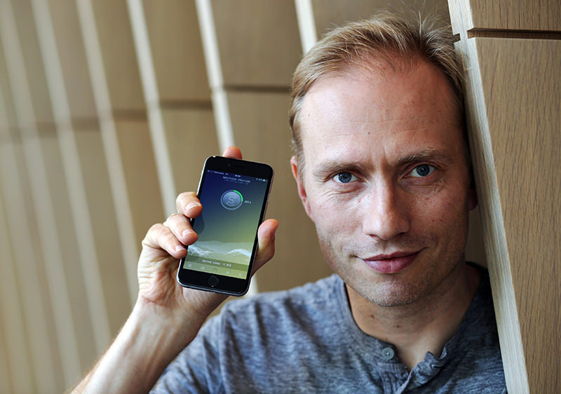 Co-founder of sweatcoin Oleg Fomenko poses for a photograph with the sweat coin app open at his office in London, Britain May 4, 2016. (REUTERS Photo)