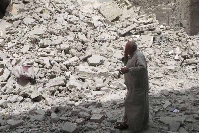 A man passes by the rubble of a building in Aleppo.