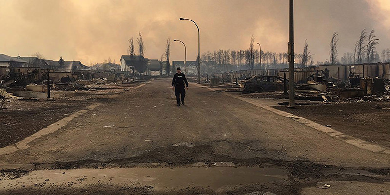 As the wildfire in Fort McMurray continues to burn More than 1,110 firefighters, 145 helicopters, 138 pieces of heavy equipment and 22 air tankers are fighting the fires. (EPA Photo)