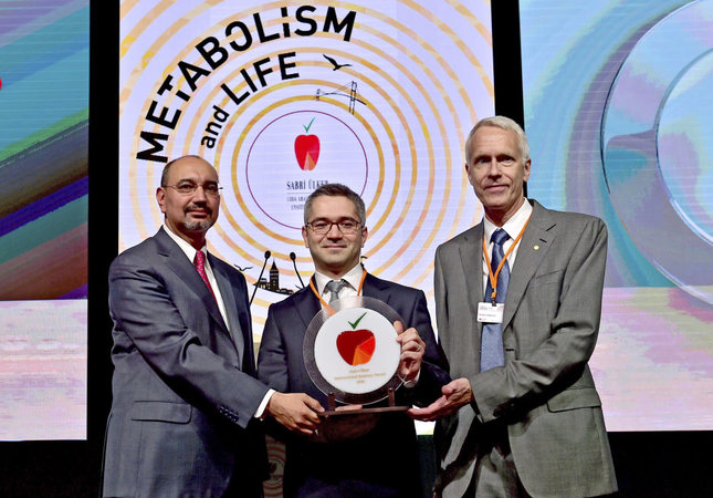 Ali Ülker (L), Kıvanç Birsoy (C) and Brian Kobilka (R). Professor Kobilka of Stanford University won a Nobel Prize in Chemistry in 2012.