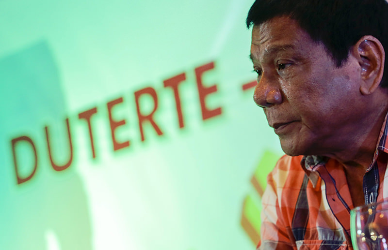 Filipino presidential candidate Davao City Mayor Rodrigo Duterte listens to questions during a press conference after he cast his vote for the National Election Day in Davao city, southern Philippines, 09 May 2016. (EPA Photo)