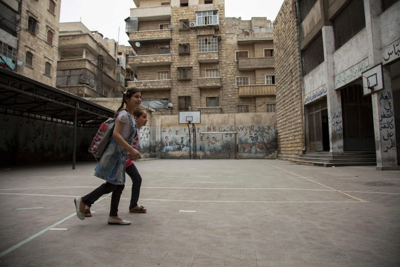 Syrian girls arrive at school in Aleppo's opposition-held eastern district of Shaar on May 7.