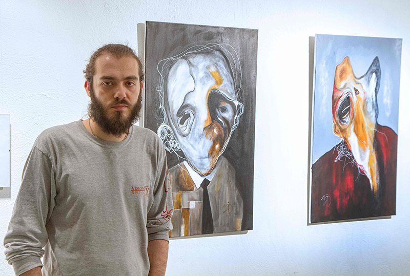 Syrian painter and graphic designer Majd Kara poses for a picture on April 23, 2016 in Vilnius. (AFP Photo)