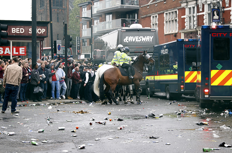 General view as bottles are thrown at the Manchester United team bus before the match (Reuters Photo)