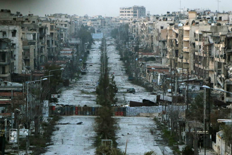 A general view shows a damaged street with sandbags used as barriers in Aleppo's Saif al-Dawla district in March 2015. In the year that has passed, the city has suffered further sunk into ruin.