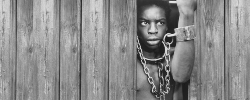 A scene from the 1977 mini-series ,Roots, which is an adaptation of Haley's namesake novel.