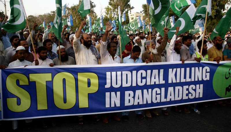 Student supporters of the Jamaat-e-Islami hold a banner during a protest in Karachi, Pakistan on May 11.  (EPA Photo)