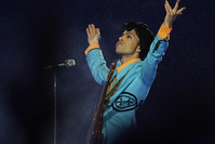 In this Feb. 4, 2007, file photo, Prince performs during the halftime show at Super Bowl XLI at Dolphin Stadium in Miami. (AP Photo)
